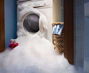 water damage caused by washing machine overflow